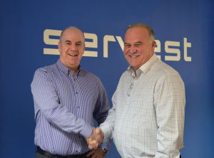 Pro-Check and Servest shake hands