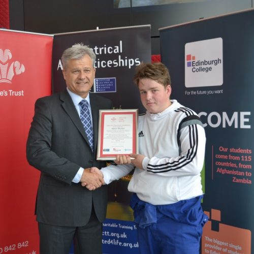 Aaron Bryson receiving his certificate from Edinburgh College Assistant Principal